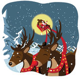 Santa and reindeer fly by Royalty Free Stock Photos