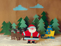 Santa with reindeer in the forest Stock Photography