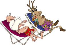 Santa and reindeer having a rest Royalty Free Stock Photos