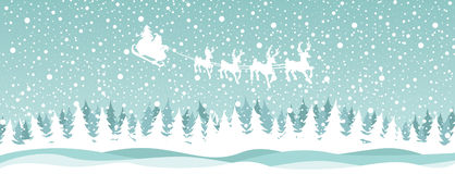 Santa reindeer over the forest Stock Images