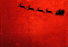 Santa and the Reindeer. A silhouette of Santa Claus and the reindeer on a red velvety background. Room for copy Stock Photo