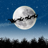 Santa Reindeer Sleigh. Illustration of Santa Claus and his reindeer sleigh in silhouette against a blue winter landscape Stock Photos