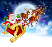 Santa Reindeer Sleigh Cartoon Christmas Scene. Santa Claus cartoon character in his sled sleigh with his red nosed reindeer delivering gifts in flying in front Stock Photography