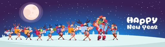 Santa With Reindeers Carry Stack Of Presents Outdoors At Night Horizontal Happy New Year Banner Design Royalty Free Stock Images