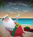 Santa relaxing on tropic beach. With martini,gifts and Merry Christmas and Happy New Year text Stock Photography