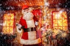 Santa repairing home. Portrait of Santa Claus in helmet repairing his home. Christmas and New Year concept stock images