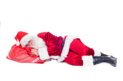 Santa resting on the bag with presents. Stock Photos