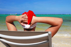 Santa resting on chaise longue. On caribbean sea royalty free stock photography