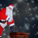 Santa Resting Foot on Chimney Stock Photos