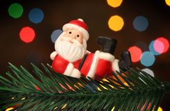 Santa resting over a christmas branch tree Stock Photo