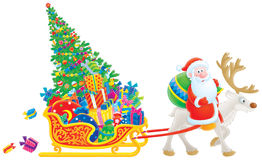 Santa rides on Reindeer dragging the sledge Royalty Free Stock Photography