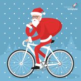 Santa riding bicycle Stock Images