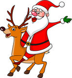 Santa riding deer Royalty Free Stock Image