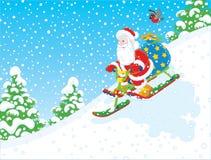 Santa riding a snow scooter Stock Photo