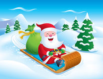 Santa Riding Toboggan Down Slope fotografie stock libere da diritti