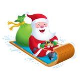 Santa Riding Wooden Toboggan Snow Sled Royalty Free Stock Photography