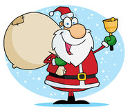 Santa ringing a bell and carrying his toy sack Stock Photo