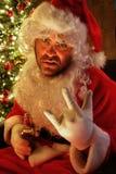 Santa rocking on and drinking beer Royalty Free Stock Photos