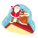 Santa on a roof house. Royalty Free Stock Photography