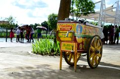 Vintage Ice Cream wooden Mobile Cart on city sidewalk. Santa Rosa City, Laguna, Philippines - October 28, 2016: Vintage Ice Cream wooden Mobile Cart on city Royalty Free Stock Photography