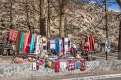 Handicraft seller at Santa Rosa de Tastil Village - Santa Rosa de Tastil, Salta, Argentina. Santa Rosa de Tastil, Argentina - Apr 26, 2018: Handicraft seller at stock photography