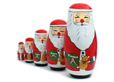 Santa Russian Nesting Dolls. A set of Russian nesting dolls in the image of Santa Claus placed in a row on an isolated white background Stock Images