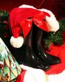 Santa& x27; s靴子和帽子 免版税库存图片