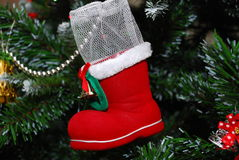 Santa's boot. A santa boot kept on a christmas tree to decorate the tree royalty free stock images