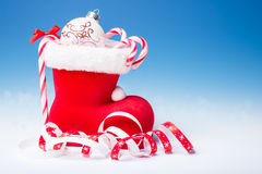 Santa's boot with candy canes, text space Royalty Free Stock Images