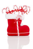 Santa's boot with candy canes Royalty Free Stock Photos