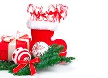Santa's boot and Xmas candy Stock Photography