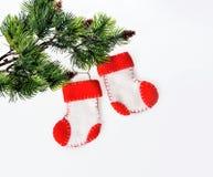 Santa's boots on christmas tree Stock Photos