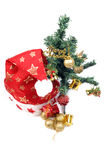 santa's cap and christmas tree Royalty Free Stock Photo