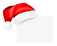 Santa's cap hanging on a blank card Royalty Free Stock Images