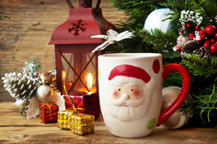 Santa's Cup with Christmas Decoration Background Stock Photos