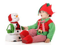 Santa's Elf Testing Toy Snowman stock images