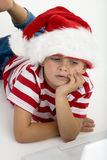 Santa's elve placing order on laptop Royalty Free Stock Images