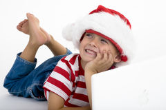 Santa's elve placing order on laptop Stock Image