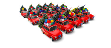 CHristmas Santas elves / Santa Army. Car group in red color and loaded with Christmas tree and gifts Royalty Free Stock Image