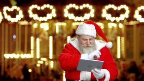 Santa`s explaining something. stock video footage