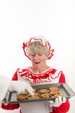 Santa's hand stealing a cookie Royalty Free Stock Photo