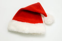 Santa�s hat. Lies on a white background Royalty Free Stock Photography