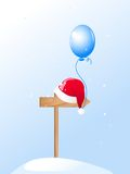 Santa's Hat and blue balloon Royalty Free Stock Photo
