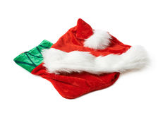 Santa's hat and Christmas stocking isolated Royalty Free Stock Photos