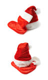 Santa's hat and Christmas stocking isolated Royalty Free Stock Photography