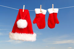 Santa's hat and gloves drying Stock Photography