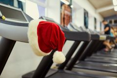 Santa`s hat in the gym. Royalty Free Stock Photography