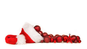 Santa`s hat with red christmas decoration balls stock photo