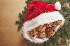 Santa& x27;s hat. On a wooden background Stock Image