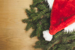 Santa& x27;s hat. On a wooden background Royalty Free Stock Photo